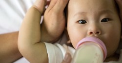 Babies fed cow's milk too early are more likely to become overweight image