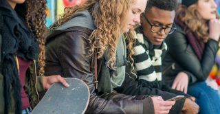 Teenage girl uses smartphone