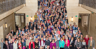Group photo of the guests at the NSHD 70th birthday celebration