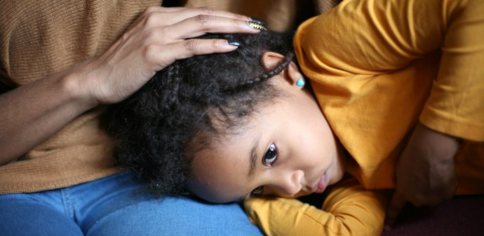 Importance of early intervention - unhappy girl sits with mother