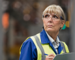 Middle aged woman at work wearing a hi-vis jacket