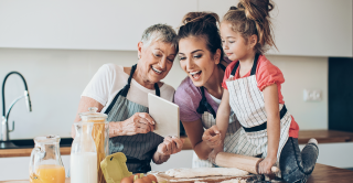 A grandmother in the kitchen with her daughter and granddaughter