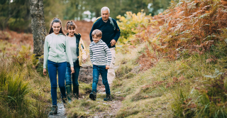 Parents and children walking in the woods