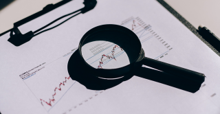 Magnifying glass on a line graph
