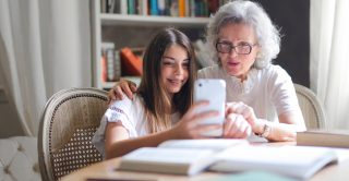 Grandmother takes selfie with her granddaughter