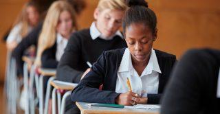 Schoolgirl sits a written exam